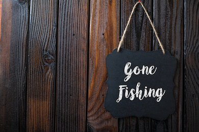 gone-fishing-sign-written-chalk-260nw-498873172